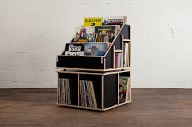 based in portland oregon the small studio produces handmade units inspired by record display cases that up to 600 records
