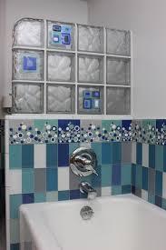 mid sized minimalist kids blue tile and glass tile ceramic floor freestanding bathtub photo