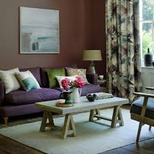 Country living room designs Rustic Country Purple Living Room With Dusky Walls And Rustic Furniture Ideal Home Country Living Room Pictures Ideal Home