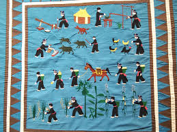 PUBLIC MUSEUM FEATURES HMONG STORY QUILT EXHIBIT - KSCJ 1360 & A new exhibit featuring story quilts and cloth whose origins stem ... Adamdwight.com