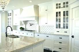 grey granite countertops with white cabinets this striking contemporary kitchen