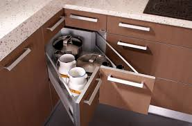 View in gallery Butterfly corner drawers in the kitchen help tuck away  those extra pots and pans [Design