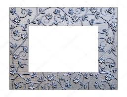 a silver picture frame trimmed with flowers photo by noonie
