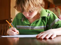 how to help your child write a better essay blonde kid writing