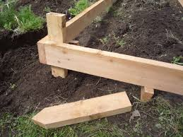 the bed sides into the stakes now you can kick out the blocks and the box will stay in place and be level