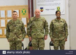 Lt. Col. Brandye Williams (right) took charge of the 2/238th ...