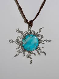 tribal sun necklace wire wrapped blue stone