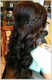 a hive a halo braid and defined curls go hand in hand to plete this prom tastic look