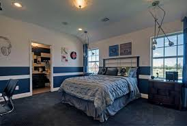 bedroom with two toned wall colors and chair rail