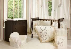 bedroom dark brown wooden cradle with cream bedding set having winnie the pooh picture feat