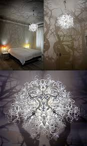 creepy chandelier lamp turns your room into a shadowy forest