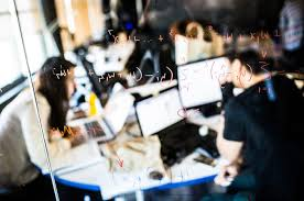 As Tech Booms, Workers Turn to Coding for Career Change - The New ... Employees of Silicon Valley Bank work at their desks behind glass covered with equations at Galvanize, a coding school in San Francisco.
