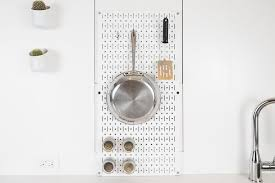 we like that you can use the wall control metal pegboard to hang cookware and utensils