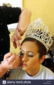 apr 27 2007 san antonio tx usa miss fiesta san antonio 2007 samantha garcia has her makeup applied before the battle of the flowers parade