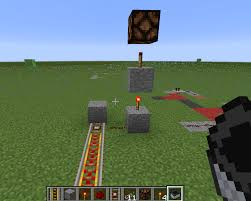 when the cart stops on the detector rail it will send a signal to the redstone lamp turning it off and allowing the one on top to turn on witch will power