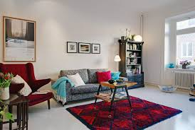 Living Room : Pictures And Painting On The Wall With Bookshelf In Right  Side Of Sofa And Red Chair In The Left And Then Folding Chair On Top Of  Carpet ...