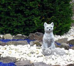 stone figures figures cat white
