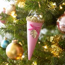 Offer guests treat-filled homemade paper cone ornaments straight off the Christmas  tree. Victorian cone ornaments
