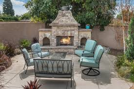 outdoor fire place with stone veneer