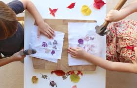 to begin arrange the petals and leaves onto a piece of watercolour paper if you want to turn the finished print into a greetings card simply fold the
