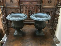 pair small antique cast iron garden urn
