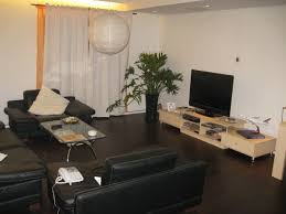 charming light wood floor diagonal study room style a light wood flooring with dark furniture and