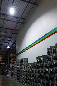 150 watt high power led high bay light fixture shown installed on warehouse ceiling closest light in photo
