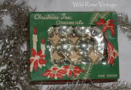 for kathleen s white wednesday a few silver mercury glass old tinsel garland glass bead garlands and a few vintage bottle brush wreaths