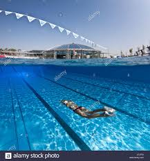 olympic swimming pool underwater. Contemporary Pool A Female Swimmer Training In An Open Air Olympic Swimming Pool France  Underwater View With Swimming Pool E