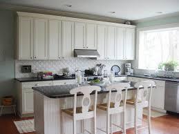 caulking kitchen backsplash. White Tile Backsplash And Black Granite Countertop Combination For Modern Kitchen Design Ideas With Cabinet Set Caulking