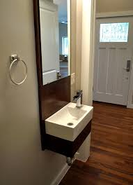 beautiful waterfall faucet in bathroom transitional with powder room sink next to tiny sink alongside small