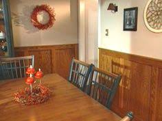 frame and oak panel wainscoting dresses up room