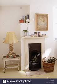 Small Bedroom Fireplaces Pebble Encrusted Lamp On Painted Stool Beside Small Fireplace In