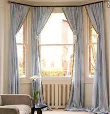 large windows with light blue long curtains