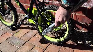 balance buddy bike handle preventing back ache when teaching your kids to ride a bike you