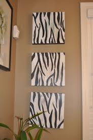 I like the color of the walls and the idea of using different animal prints  in the bathroom: zebra, leopard, and tiger.