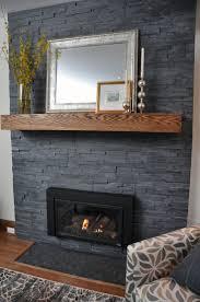 living room fireplace clad in erthcoverings springwood black series natural stone veneer