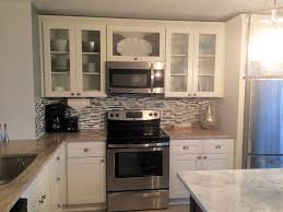 frosted white shaker cabinets with glass inserts