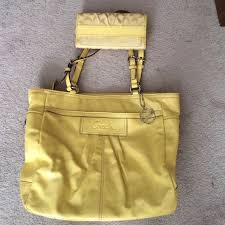 Beautiful large yellow Coach purse and wallet.