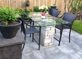 Leisbeth made this gorgeous patio dining table using paver patio coffee table ideas