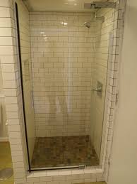 Small Shower Stall With Glass Door And Subway Wall Tile
