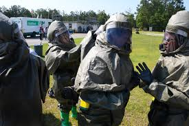 u s department of defense photo essay airmen check each other s chemical protective suits after arriving at the scene of a simulated chemical