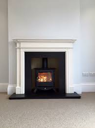 chesneys beaumont 5kw wood burning stove with limestone surround slate hearth and slips