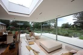 shenfield mill an open glass extension case study slim frame interior view looking out onto the garden through floor to ceiling sliding