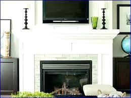 tv on fireplace mantel ideas with brown decorating above f5 decorating