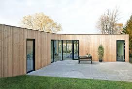 modern concrete patio designs. Contemporary Minimalist Wooden House Design Modern Wood Cool Grey Concrete Patio Idea Chic Black Chair Elegant Designs E