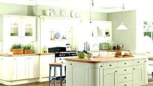 sage green kitchen in traditional with white subway tile lighted pot