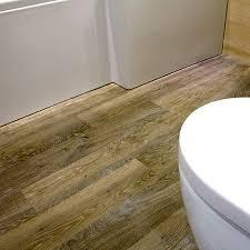 this modern bathroom dispaly at uk tiles direct in wareham features karndean wood effect plank vinyl