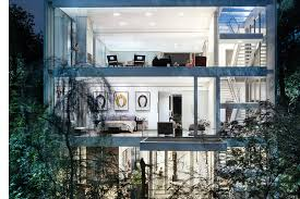 the vertical house is a modern oasis located in the middle of dallas texas surrounded by lush exotic plants the property rises 60 feet tall and is