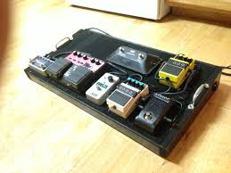 picture of diy powered pedal board with input jacks
